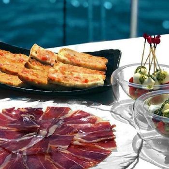 Sail around Barcelona while savouring a selection of authentic Spanish tapas.